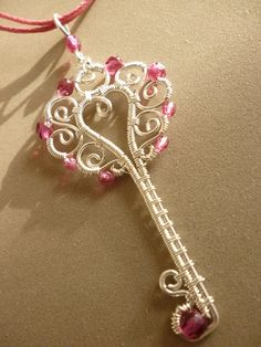 Pink Key pendant wire wrapped jewelry. $21.00, via Etsy.