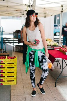 Visiting the farmers market is your weekend must do — it's where you get your produce for the week, but it's also where you chat with your local purveyors. A woven can help hide sweaty hair, and a bright green tied at the waist introduces a bright shade to the monochromatic look. Don't forget your .