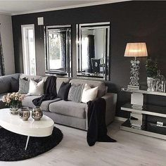 Idee per arredare un salotto classico con il grigio e con il bianco.