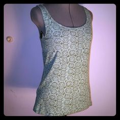 Soft Stretch Cotton blend ribbed tank Eddie Bauer Soft and stretchy, this classic tank is by Eddie Bauer. Sz women's medium,  with about double the size in stretch. It's a pretty mint and grey soft geometric print, measures 36 inches at bust and 27 inches long from shoulder to hem. It's gently pre-owned with no visible damage. I accept offers and offer discounts and bundles! Questions? Just ask! Eddie Bauer Tops Tank Tops