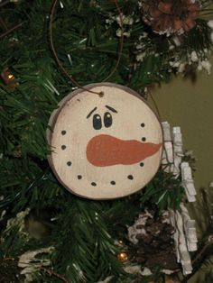 Slice of wood from a branch. Painted snowman face. Cute and rustic.