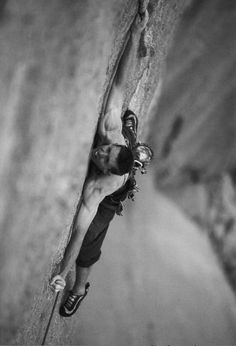 Photo: Tommy Caldwell freeing the sixth pitch (5.14) of the Dihedral Wall in 2004. Photo by Corey Rich Productions.
