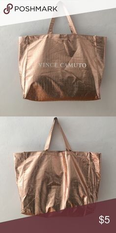 Vince Camuto Re-usable Bag This is a thin gold snake print tote. Perfect to use when grocery shopping! A great add on for bundle discounts! Vince Camuto Bags Totes