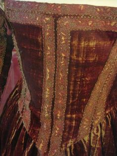 """ca. 1560 Italy, Florence. Bodice. Currently in the Museo di Palazzo Reale, Pisa. Believed to be from 1560, this is called the """"Red Dress of Pisa."""" It is a Florentine gown from the sixteenth century - it was found on a wooden effigy at San Matteo. It is housed at the Palazzo Reale di Pisa (Museum Nazionale). It is made of red velvet with gold couched trim."""