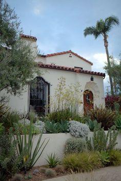 Desert plants outside spanish home.