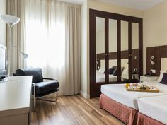Barcelona Arenas Atiram Hotel Spain, Europe The 4-star Arenas Atiram Hotel offers comfort and convenience whether you're on business or holiday in Barcelona. Featuring a complete list of amenities, guests will find their stay at the property a comfortable one. Facilities like free Wi-Fi in all rooms, 24-hour room service, Wi-Fi in public areas, room service, babysitting are readily available for you to enjoy. Guestrooms are designed to provide an optimal level of comfort with ...
