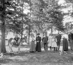 Montezuma, Summit County, Colorado, 1891-1893. Men, women, and children pose in shade in   Montezuma, Summit County, Colorado. A boy in a sailor suit is astride a donkey, and   young women hold kittens. A dog lies in the foreground, and a residence shows through   trees in the background.     Courtesy: Western History/Genealogy Department, Denver   Public Library, Denver, Colorado (USA).