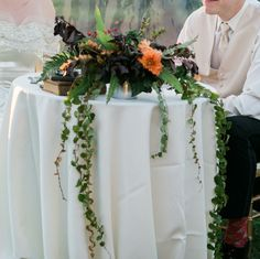 Sweetheart table. Vines, Dahlia, Nine bark. Ferns.  www.forestandfieldcreative.com