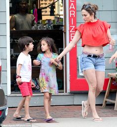 Stylish kids: Her two children were dressed for the beach: Emme had on a dress with a sun on it while Max wore red shorts and a T-shirt