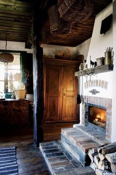 In the past, the hearth or fireplace was an essential part of country living. Most people cooked in their fireplaces and used them as an essential source of heat. Even though fireplaces are common features in many modern homes, they… Continue Reading → Rustic Fireplaces, Cozy Fireplace, Country Fireplace, Cottage Fireplace, Cabins And Cottages, Cottage Interiors, Rustic Interiors, Cabins In The Woods, Cottage Style