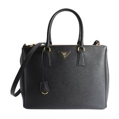 Prada Black saffiano leather top handle bag ($1,976) ❤ liked on Polyvore featuring bags, handbags, shoulder bags, black, shoulder strap handbags, man leather shoulder bag, leather shoulder handbags, genuine leather handbags and hand bags