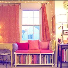 What an awesome window seat! I also love the curtains and the lights hung up!
