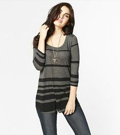 #DYNHOLIDAY Stripe a pose in this sexy striped tunic! Pair it with legging or jeans for the perfect casual look.