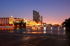 The Grand Rapids, Michigan, skyline and the Grand River at night. Discover more at www.discoveramerica.com.