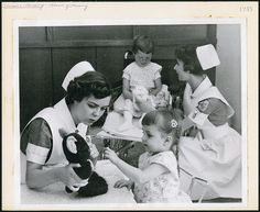 Two student nurses amusing young patients at the Children's Hospital school of nursing in Winnipeg. #vintage #nurses #Canada