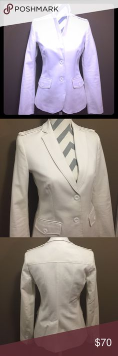 """Calvin Klein Button Tab Stretch Blazer Like new condition. Great blazer that pairs beautifully with dark wash jeans and a tank top. Cotton fabric with lots of stretch that is super soft. Front pockets with buttons and button tabs on each shoulder. Length is 24"""". 97% cotton and 3% spandex. Calvin Klein Jackets & Coats Blazers"""