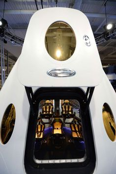A view from outside the entry hatch inside SpaceX's new seven-seat Dragon V2 spacecraft at a press conference to unveil the new spaceship, in Hawthorne, Calif., on May 29, 2014.