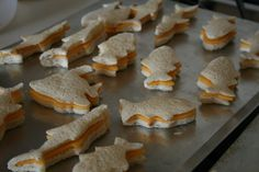 Fish shaped grilled cheese! Perfect for our Happy Feet party. :)