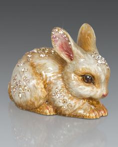 """Bunny made of cast metal. 18-kt. matte-gold and light antique-brown finish. Hand enameled and hand set with Swarovski crystals. 2""""W x 3.75""""D x 3""""T. Imported."""