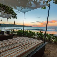 Watching the sunset over Jimbaran Bay in Bali Indonesia.  _  Beach views from Intercontinental Bali are gorgeous day after day. Come for the buffet... stay for the sunset.  _  What would you be drinking if you were sitting here?  _  If you're interested in this resort for your next vacation to Bali check out the link in my bio @travelwithbender.  _  We're currently exploring Nashville Tennessee the hallowed home of country music. I love using our @tepwireless for unlimited Internet access on…