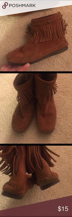 Minnetonka Booties They fit more like a 7.5. These have been well loved, but still have a lot of life left. Wear noted in the last picture. Minnetonka Shoes Ankle Boots & Booties
