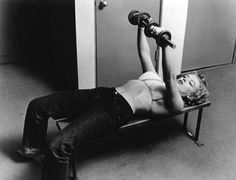Marilyn Monroe lifting weights - by Philippe Halsman