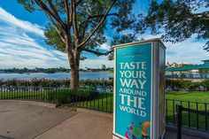 The Taste your way around the world sign at the Food and Wine Festival. It happens at epcot in September.