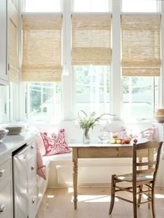 so light and airy. the bamboo shades really top off the look.   via theinspiredroom.net