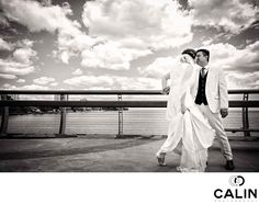 Photography by Calin - Humber Bay Arch Bridge First Look:  As a Toronto wedding photographer with a lot of weddings under my belt, I always advise my couples to avoid a crowded wedding photography locations. However, my couple was reticent and insisted that we use Humber Bridge as their location for the bride's unveiling. The beautiful bridge is commonly used for engagement photos, and in my experience, one has to shoot early in the morning to avoid the large crowds. Even more, the bride…