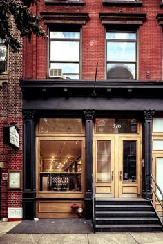 Built by Jane Kim Design in New York, United States with date Images by Alan Tansey. The Counter Culture Coffee Training Center is dedicated to coffee education for both professional baristas and home b. Coffee Shop Design, Cafe Design, Store Design, Shop Front Design, Restaurant Hotel, Restaurant Design, Exterior Design, Interior And Exterior, Exterior Signage