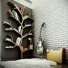 modern day Jon Snow's room: Tree shelf, fur rug, exposed brick walls and you KNOW hottie like him would be rocking the guitar. all in a bleak Knight's Watch black and white palette (with a weirwood throne in there for good color)