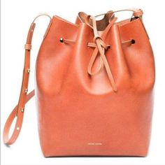 Mansur Gavriel large bucket bag Like new bucket bag worn a few times. Brandy with avion interior. Comes with attached wallet and dust bag. Hard to find! From Steve Alan boutique. Mansur Gavriel Bags Crossbody Bags