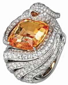 Cartier 22-carat, cushion-shaped yellow sapphire, fancy yellow diamond and  brilliants set in platinum