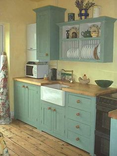 small country kitchen, but use one side of lower cabinet for an apartment size dw.  the other side of the el would be for food and other pantry items.  this is even the color and floor i would like.