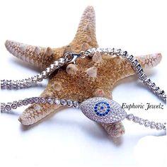 A pavé Swarovski Zirconia Crystal evil eye designfor good luck and positiveenergy.  Shop this product here: http://spreesy.com/EuphoricJewelz/36  Shop all of our products at http://spreesy.com/EuphoricJewelz  Pinterest selling powered by Spreesy.com #EuphoricJewelz #finejewelry #sterlingsilver #tennisbracelet #evileye #goodvibes #goodenergy #bracelet #goodluckcharm #swarovskizirconia #pavejewelry #swarovskibracelet #finejewellery #jewelry #jewelrydesign #jewelryinspiration #jewelrygram…