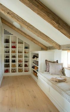 Clever Attic Storage IdeasAttic Closet Ideas - Walk-in attic wardrobe includes a sloped ceiling lined with rustic timber light beams over angled built in footwear cubbies and sweatshirt racks beside a window seat. Attic Master Bedroom, Attic Bedroom Designs, Attic Bedrooms, Attic Design, Bedroom Loft, Bedroom Decor, Modern Bedroom, Contemporary Bedroom, Design Bedroom