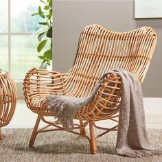 Remarkably comfortable and supportive, our curving Sairah Rattan Chair is a    statement-making piece that's smart, too. It even offers a touch of    give for a relaxed feeling when you sit down. We think this    beauty-plus-brains style is the perfect way to embrace the natural    materials furniture trend. Handwoven, wrapped, and formed by artisans using    durable natural rattan reeds, it's a beautiful choice that    doesn't take up too much visual space. Designed with a po...