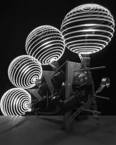 Four Spheres with Compass, Penlight, and Drill, 2007 by Caleb Charland