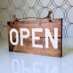 My customers who have this sign tell me they like the way it clacks against their front door. It's the sound of customers coming and going! This sign adds charm to either a front door or store window.