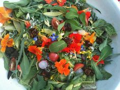 Now THIS is a salad!  YouGrowGirl's description: Nasturtium flowers, borage flowers, radishes (three kinds), giant red mustard (greens and flowers), red frills mustard (leaves and flowers), tomatoes, sundried tomatoes (gift from Abby), several lettuce varieties, 'Golden Sweet' peas and young shoots, coriander flowers, arugula (from Lorraine's garden).