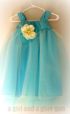 Darling tutu dress tutorial -- just a little sewing to make a tulle and fabric baby dress.