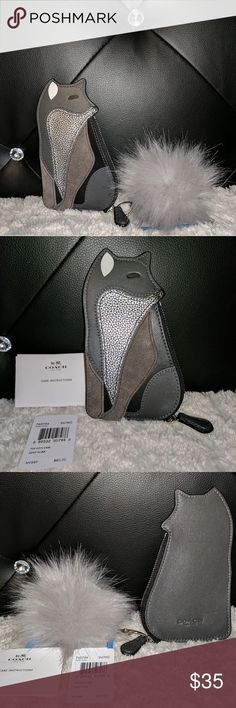 """NWT Coach Fox Coin Purse Leather Discontinued authentic NWT hues of grey and silver Coach fox coin purse. Pictures #1&#3 depict the pom I will include with purchase and it is attached to the zipper making this a possible keychain coin purse duo,and can actually hold on to a few credit cards or licensure as well as coins,cash,ear phones or anything on the small side.Constructed of leather and suede and silver zipper w/leather pull.6""""inches long @3.5 inches wide. Coach Accessories Key & Card…"""