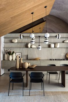 Dining Room Ideas - A large wood dining table from MisuraEmme is positioned below a large chandelier by the Italian Hangar Design Group. #DiningRoom #DiningRoomIdeas