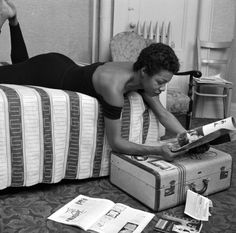 Maya Angelou doing a little reading in her dressing room before her performance at the Village Vanguard in New York City.