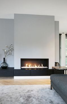 contemporary living room fireplace 1 Source by SandyMarry The post modern living room . - contemporary living room fireplace 1 Source by SandyMarry The post modern living room fireplace 1 a - Linear Fireplace, Home Fireplace, Fireplace Remodel, Living Room With Fireplace, Fireplace Surrounds, Fireplace Design, Fireplace Modern, Fireplace Ideas, Minimalist Fireplace