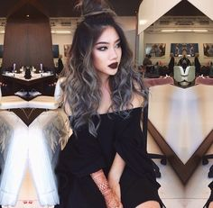 dark brown to light blondish long wavy ombre hair.  Has a bit of white hair feel to it. Very pretty