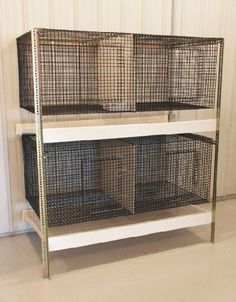 Stacking rabbit cages with collection trays underneath - great for the garage