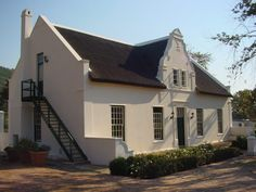 Hi all, Just wanted to know if anyone ever tried creating a 'Cape Dutch Gable' (see image below) in Chief - do I revert back to my drawing board for this one or is there an easier way of doing it? Colonial House Plans, Dutch Colonial, Fishermans Cottage, Cape Dutch, Caribbean Homes, Farm Gate, Dutch House, Grand Designs, Drawing Board