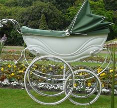 Beautiful green and white baby pram, c. 1920.