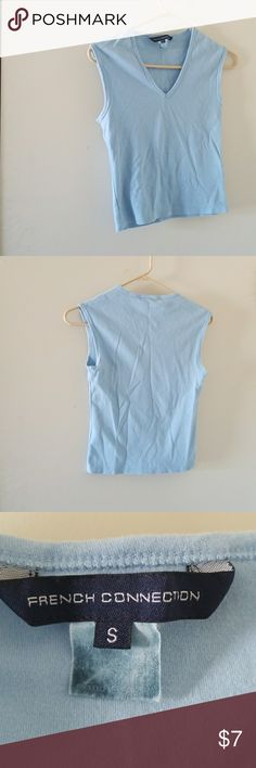French Connection blue V neck tank Cotton blue v neck tank by French Connection.  In pretty good condition but has minor lintage and a loose thread in the back where the tag is sewn.  The tag is a little faded, but other than that, it's in good condition.  See pics.  Great for working out or casual wear.  Price reflects wear.  Price is firm unless it's being bundled.  No PayPal or trade. French Connection Tops Tank Tops